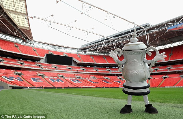 Cup run: An FA Cup trophy mascot will take part in the London Marathon on Sunday