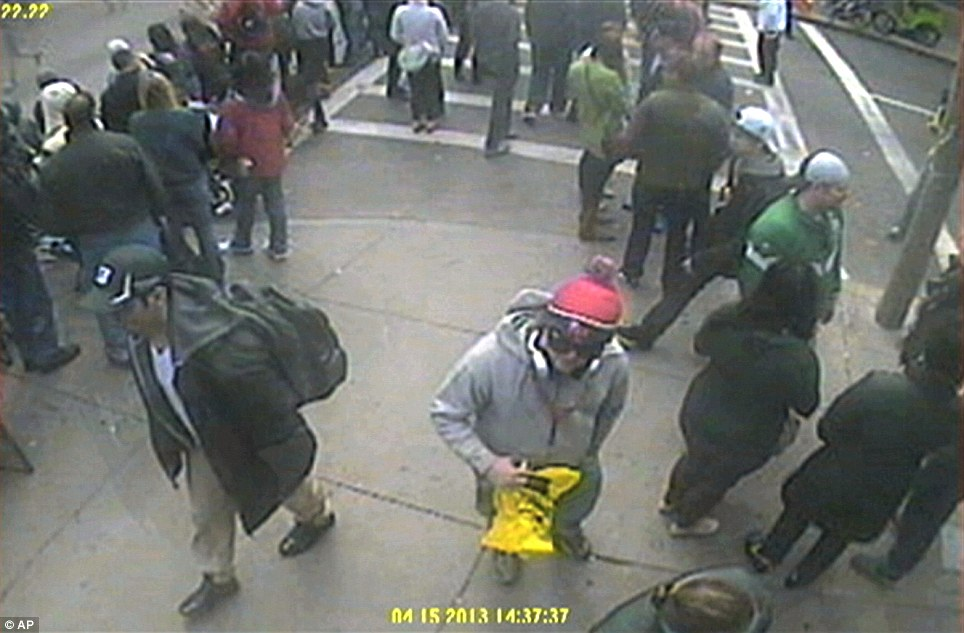 This image released by the FBI on Thursday, April 18, 2013, shows in a image from video what the FBI are calling 'Suspect Number One', front left, in black cap, and 'Suspect Number 2, in white cap, (back right)