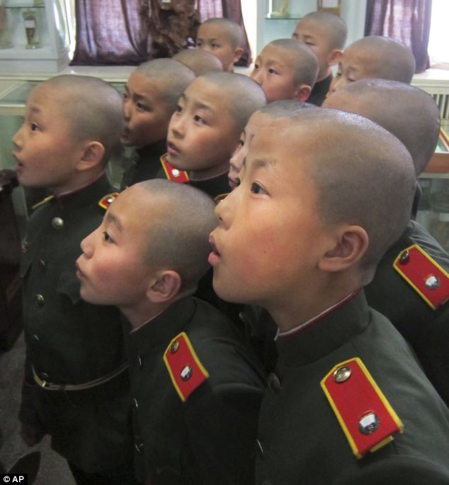 11-year-old pupils at the  Mangyongdae Revolutionary School in Pyongyang, North Korea wear military uniforms and are prepared for war