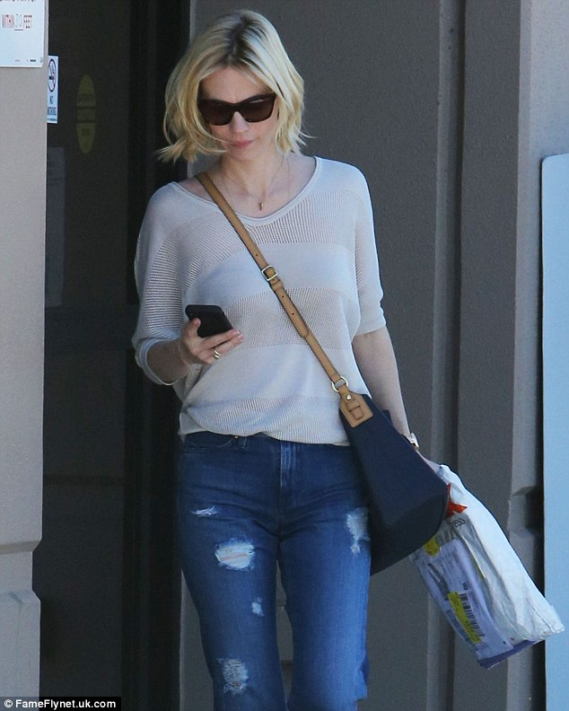 Not fussed: The star appeared to be wearing no makeup and wore her trademark short hair loose and unstyled