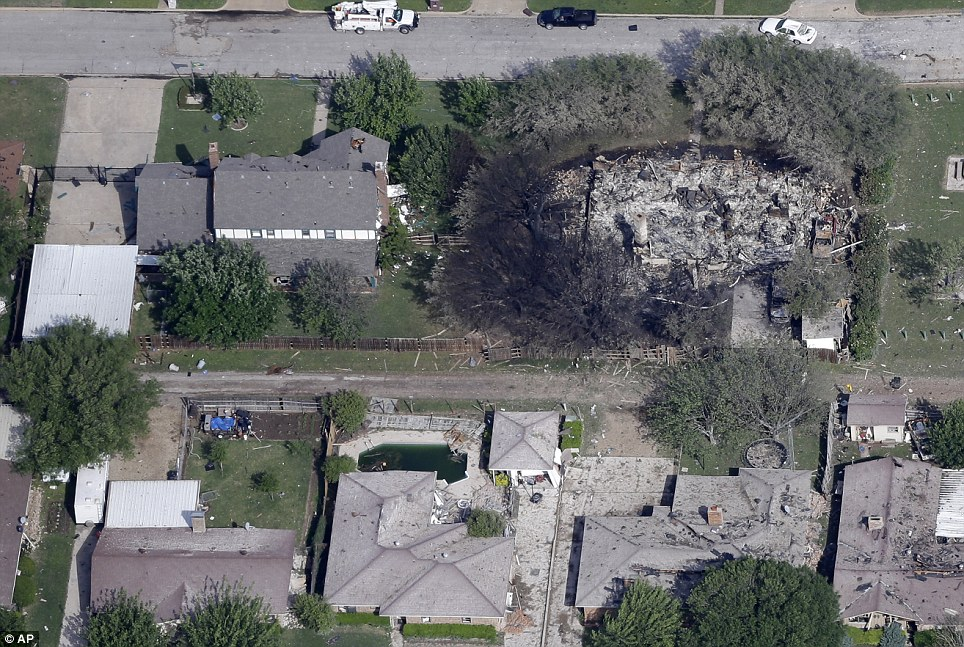 One home was razed to the ground in the ensuing fire, while others were heavily damaged by flying debris and the concussion of the blast