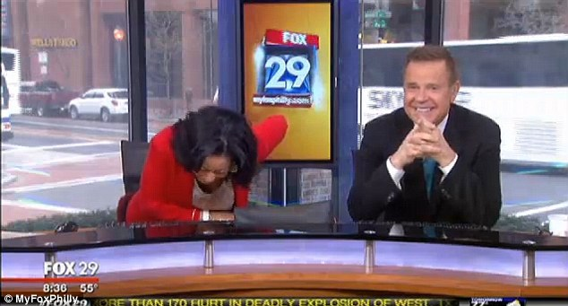 Out of control: Sheinelle Jones buckles over in laughter beside co-anchor Mike Jerrick after finishing their interview with Ryan Lochte over his new show