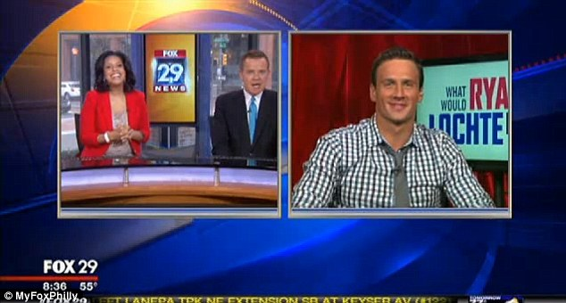 Poking fun: Anchors of Good Day Philly weren't able to contain themselves after capping an interview with Ryan Lochte that left them practically falling out of their chairs with laughter