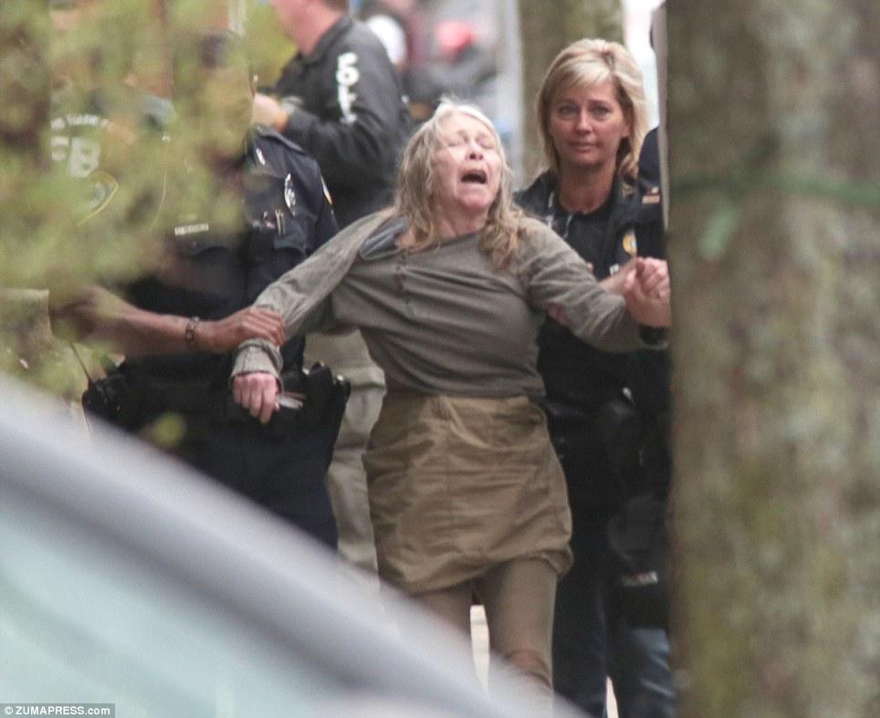 Distress: Police take away a woman near the home of 'suspect 2' Dzhokhar Tsarnaev on Norfolk Street