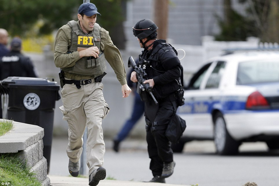 On the move: Several different agencies including the Boston police, FBI and SWAT teams were working together