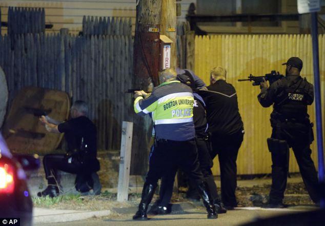 Residents described hearing: 'Gunshot, , gunshot, gunshot, gunshot' in a stand off between police and the Tsarnaev brothers