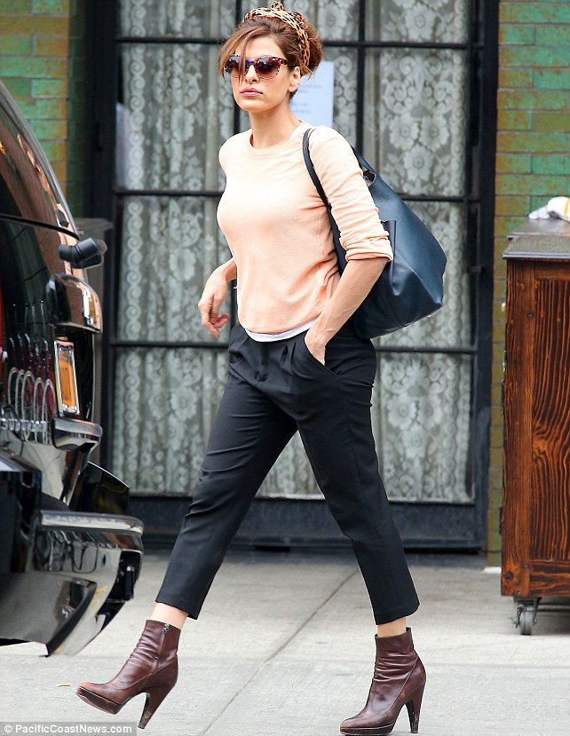 Eva looked every inch the movie star when she stepped out in New York yesterday, keeping her hair out of her face with a leopard print headscarf