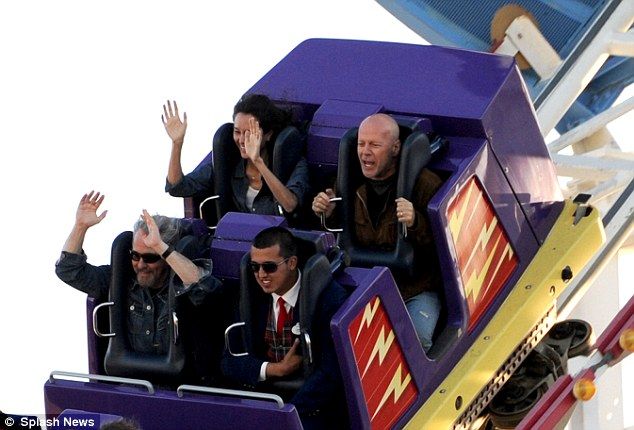 Ride hard: Bruce held on tightly while Emma was happy to throw her hands up