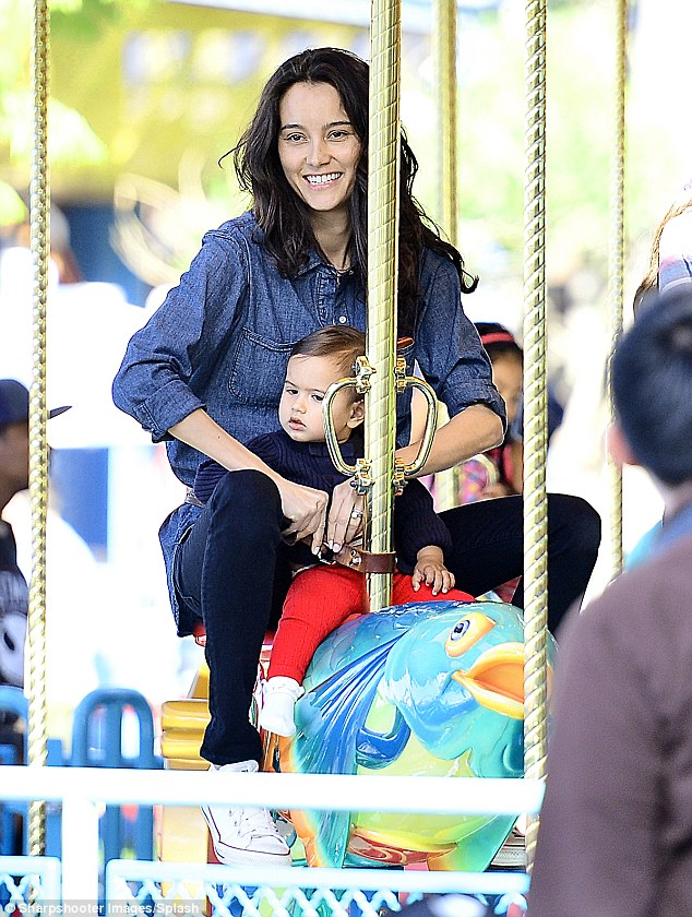 Slower pace: Emma got on a child friendly ride with one-year-old Mabel