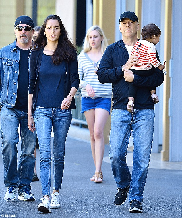 His and hers: Emma and Bruce both wore similar outfits on Tuesday in Disneyland