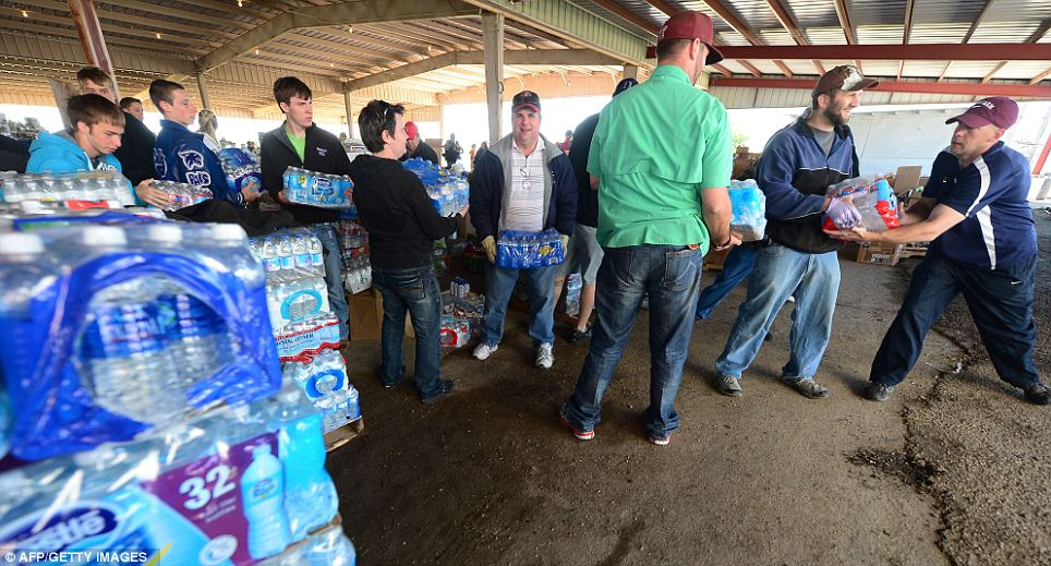 Working together: Volunteers help out at a distribution center where supplies like water and clothing, including medical supplies, are being dropped off or picked up as needed