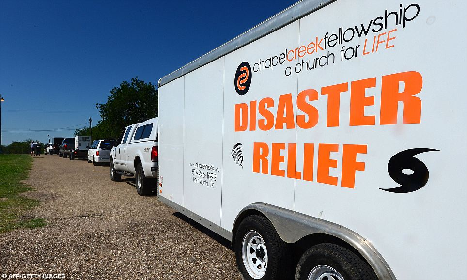 Assistance: Vehicles wait in line to offer relief to the stricken town of West, Texas, on Friday