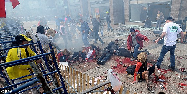 Carnage: Three people were killed and over 170 were injured when two bombs exploded on 15 April 2013 at the finish line of the Boston Marathon