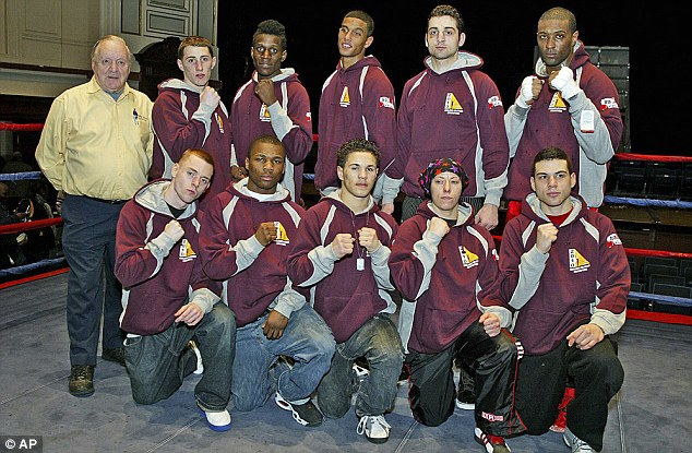 Band of brothers: Tamerlan Tsarnaev, fifth from left, top row, poses with his team at 2010 New England Golden Gloves Championship in Lowell, Mass.