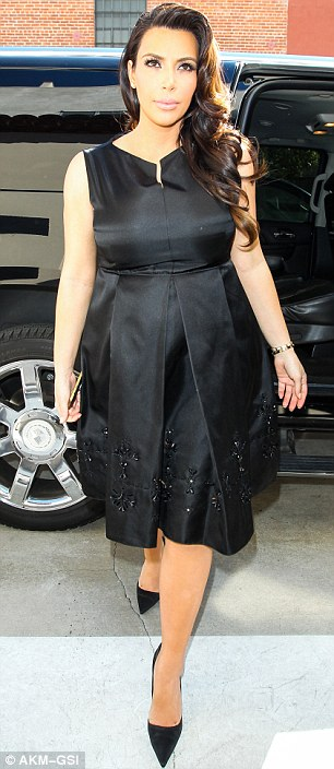Swellagant: Kim looked lovely in a black shirt dress with pleated skirt as she arrived for her date with destiny