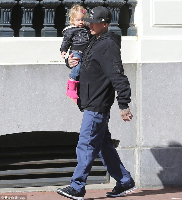 Doting dad: Carey carried Willow who was wearing Pink boots and a pink hair bow