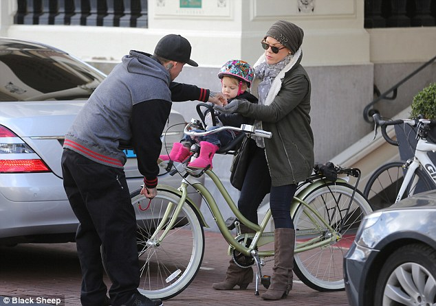 Get set: Pink and her husband Carey were seen strapping their daughter Willow onto the bike on Thursday in Amsterdam
