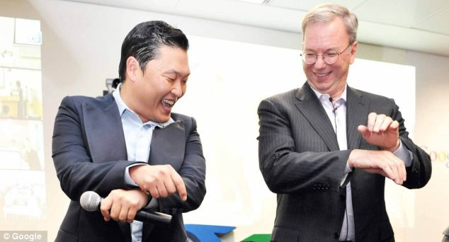 Eric Schmidt,  Executive Chairman of Google, (right) with popstar Psy
