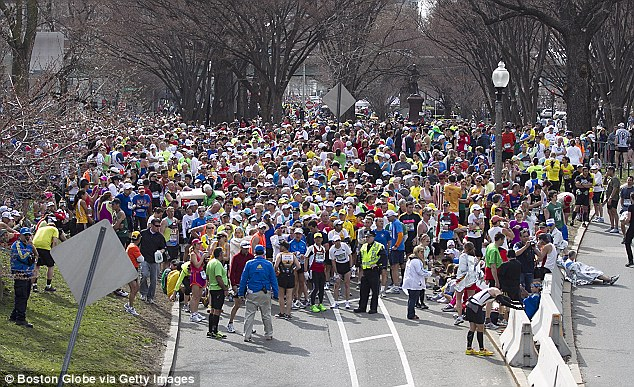 Halt: Runners who had not finished the race were stopped before the Massachusetts Avenue overpass