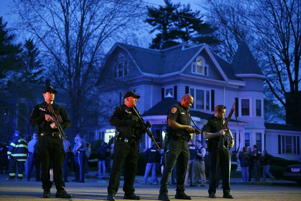 Police officers guard the entrance to Franklin street where there is an active crime scene search for suspect in the Boston Marathon bombings, Friday, April 19, 2013, in Watertown