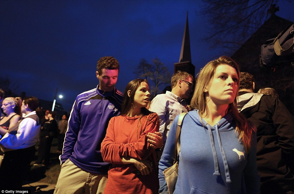 Fear: People react while watching police respond to a reported shooting on April 19, 2013 in Watertown, Massachusetts