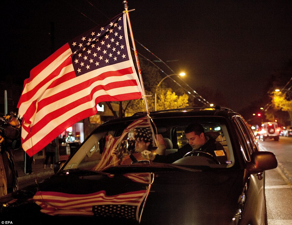 Two unidentified young men drive with an American Flag through Watertown, Massachusetts, USA, 19 April 2013, after Law Enforcement Officials apprehended Boston Marathon Bombing suspect, Dzhokhar Tsarnaev