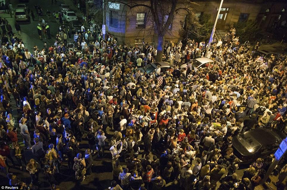 Hundreds of Northeastern University students gather in Hemenway Street to celebrate the capture of suspected Boston Marathon bomber Dzhokhar Tsarnaev in Boston on April 19th