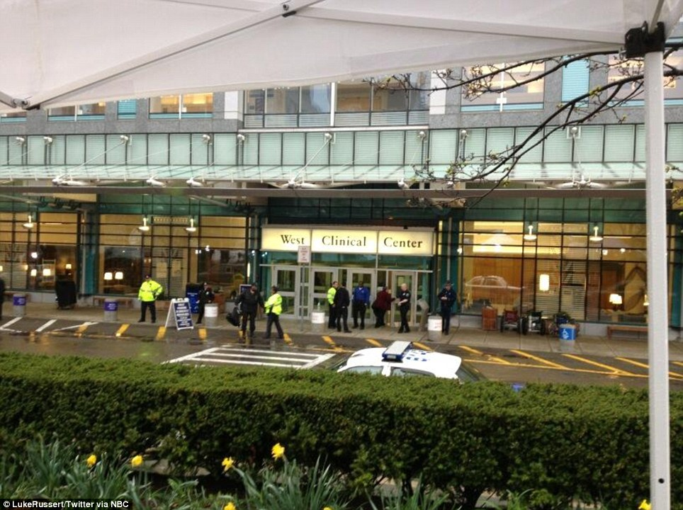Security: Law enforcement officials stand guard outside the West Clinical Center, pictured, where Boston bombing suspect Dzhokhar Tsarnaev is being treated