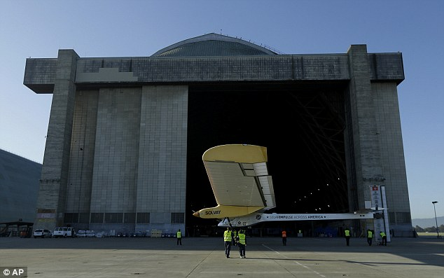 The Solar Impulse is wheeled into a hangar after its test flight