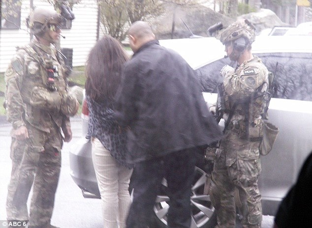 The three were apprehended after the FBI conducted a search warrant on an apartment at the complex