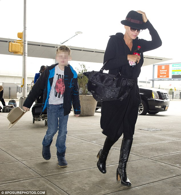 Frequent flier: Jenny McCarthy and her son Evan were spotted catching a plane heading out of New York City on Friday