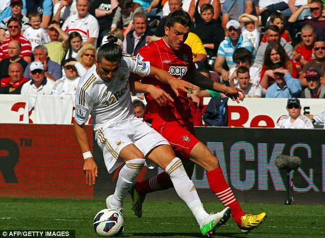 Well defended: Flores steers Jay Rodriguez away from danger