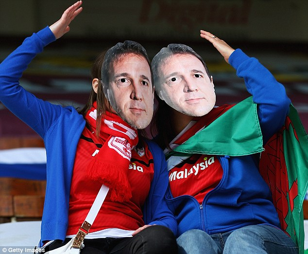 Masked man: Cardiff fans showed their appreciation for manager Mackay