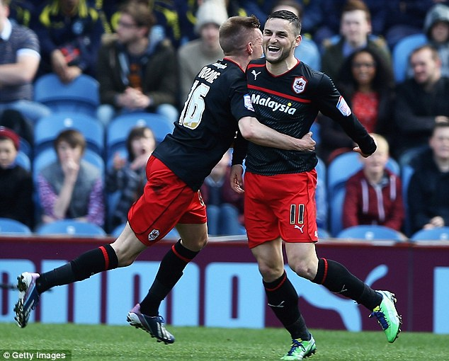 Celebration: Craig Conway is congratulated after scoring the goal that saw Cardiff seal the title