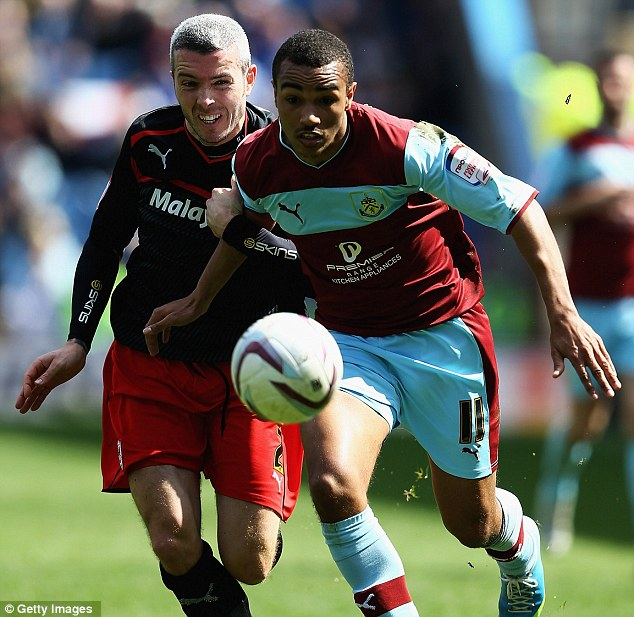 Race: Kevin McNaughton of Cardiff and Burnley's Junior Stanislas of Burnley tussle for the ball