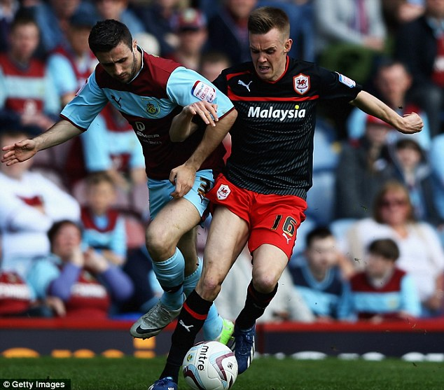 Holding off: Craig Noone shields the ball from Burnley's Danny Lafferty