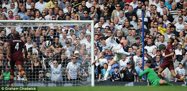 Icing on the cake: Gareth Bale (centre) adds a late third