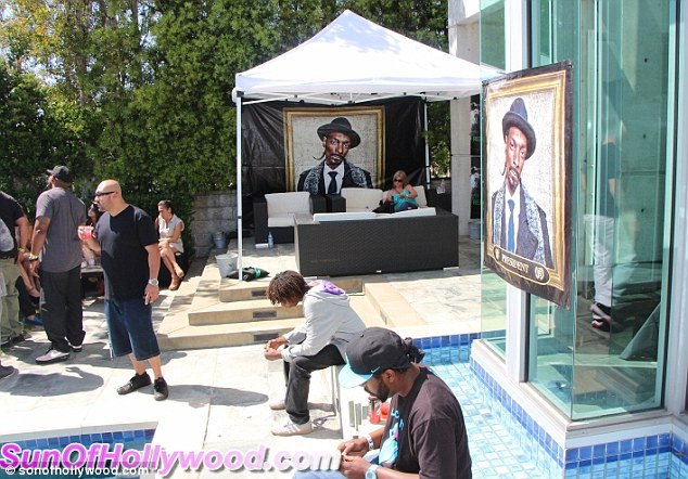 Whose party is it? Snoop makes sure the party has several pictures of himself adorning the pool