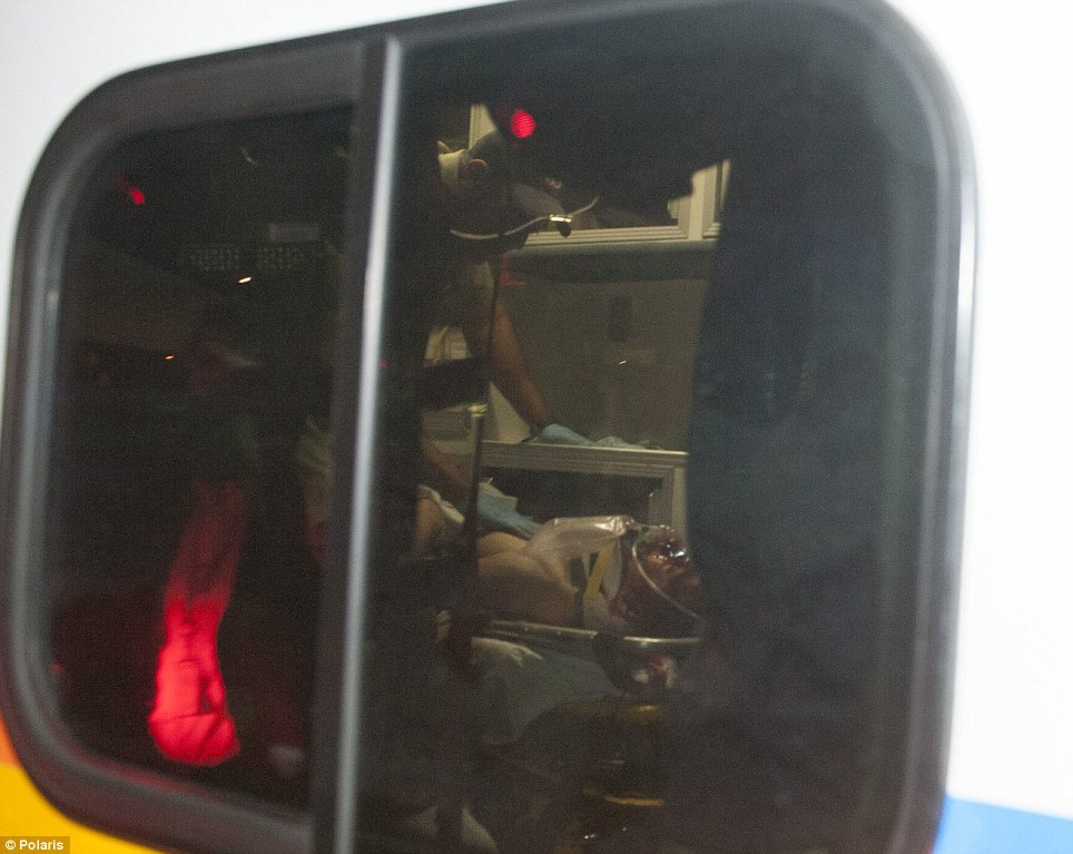 Endgame: An ambulance carries Boston Marathon Dzhokhar Tsarnaev from the scene after he was apprehended in Watertown, Massachusetts, USA on Friday