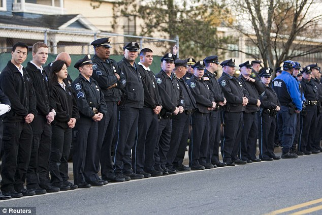 At attention: MIT police and EMT personnel stand at the Town Common in Wilmington awaiting Collier's arrival