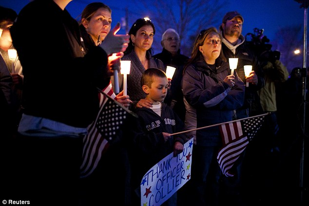 Thank you: Lisa Marriott and her son, Joseph, hold a sign and candles for Collier expressing their thanks for his service