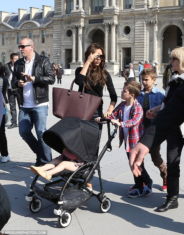 Too posh to push: Victoria let her son Cruz do some of the hard work