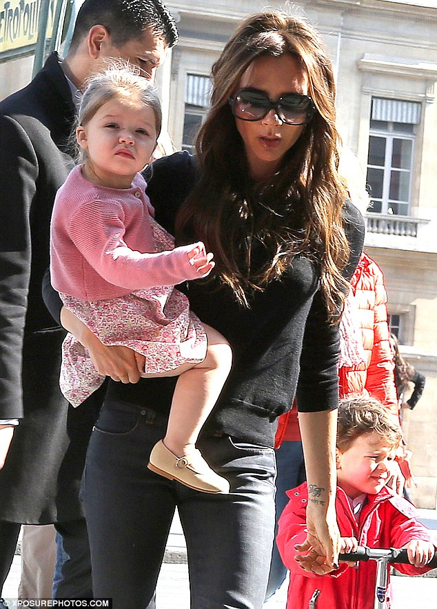 High fashion: Victoria Beckham was seen looking very stylish and cool as she took her family to the Louvre on Sunday afternoon in Paris, France