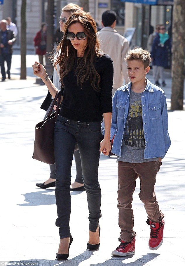 Model behaviour: Romeo held on tightly to his mother's hand as he got some alone time with her