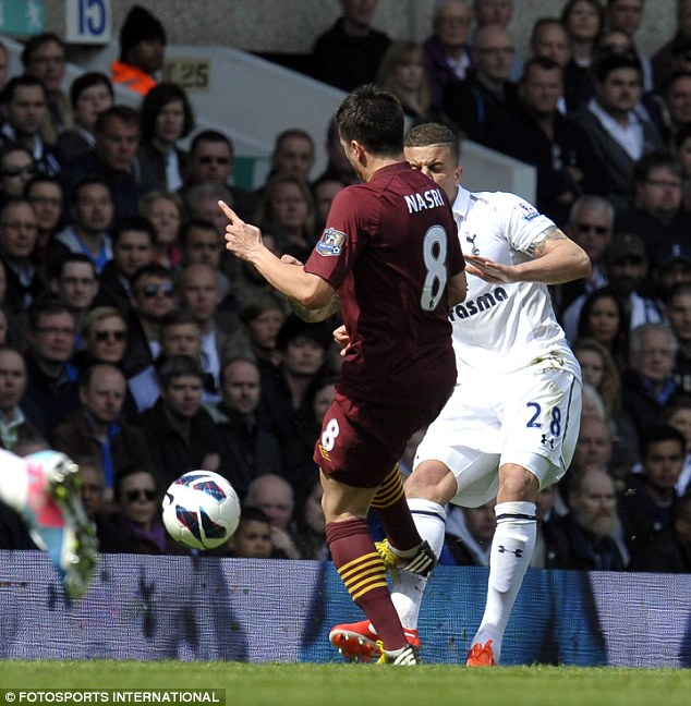 Lucky: Samir Nasri escaped punishment for this studs-up challenge on Tottenham defender Kyle Walker at White Hart Lane
