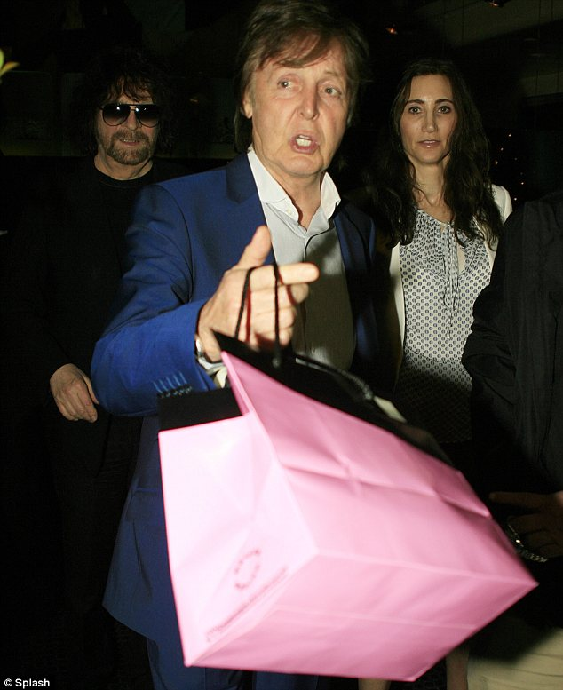 Honey Pie: Macca clutched a pink bag which looked like it contained a tasty dessert