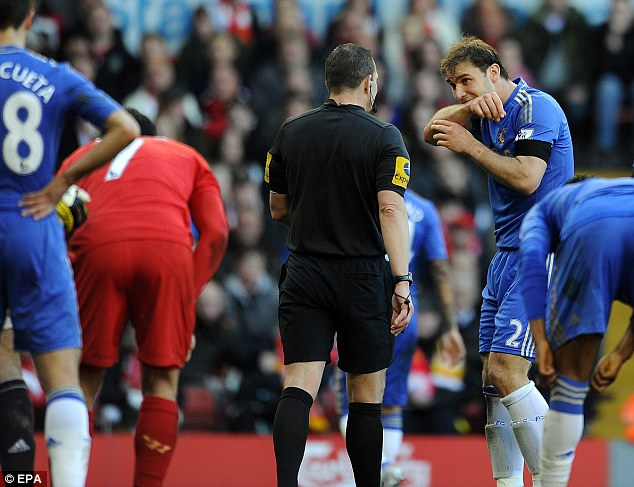 No reaction: Ivanovic recreates Suarez's bite fore referee Kevin Friend, who kept Suarez on