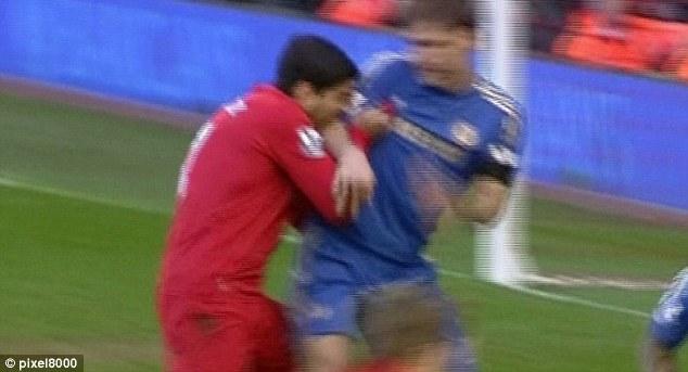 Horrific: Luis Suarez sinks his teeth into Chelsea defender Branislav Ivanovic