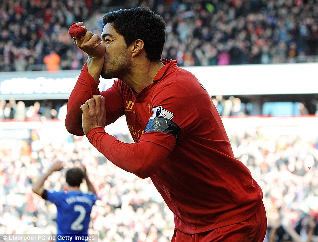 Equaliser: Suarez celebrates after netting a last-gasp leveller, but all focus is on his bite on Ivanovic