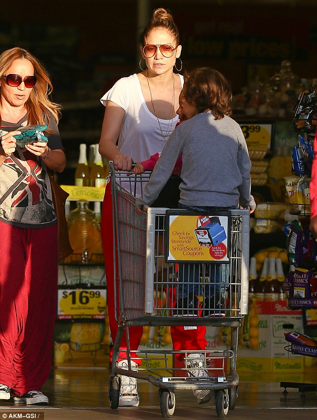 Trolley dash! J-Lo sits her twins in the supermarket trolley as they prepare to pick up some treats